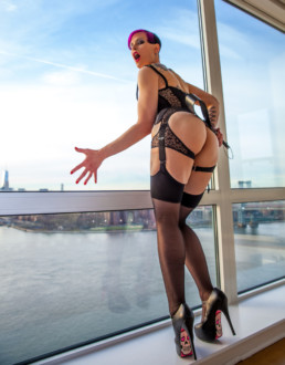 Mistress Natalie at the window
